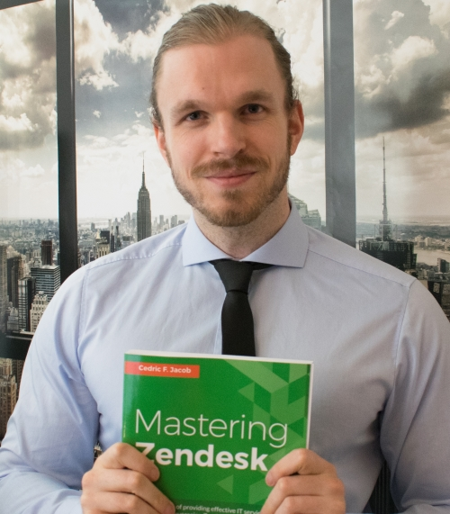 Cedric F. Jacob holding his first book: Mastering Zendesk